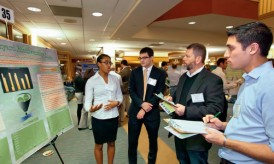 Jaimie Sheppard '17 (L-R) and Samuel Kapner '15 explain their research for  The Bushkill: Backyard Biodiversity to judges Todd Walton and Andrew Chun '12.