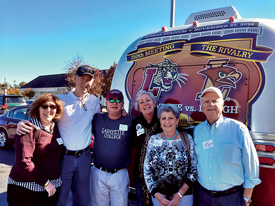 Beth (L–R) and James Maguire P'14, Michael and Jenny Weisburger '82, Bobby and Mark Weisburger '55 outside Atlanta