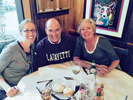 Jennifer Schott '98 (L–R) and Dennis Vitrella '73  with Jenny Weisburger '82 at the Blue Dog Cafe