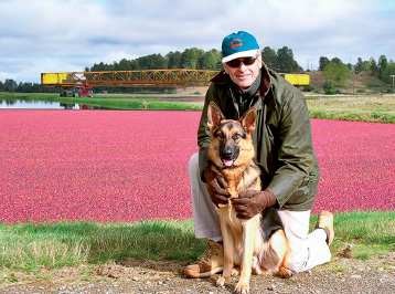Swanson poses with his dog, Rambo, in 2008 at Cran Chile farm in Valdivia.