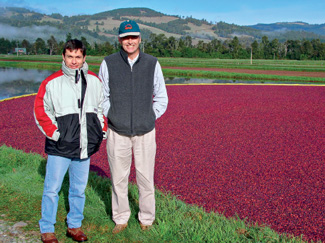Gordon Swanson '66, managing partner of Cran Chile, and head farm manager Felipe Donoso
