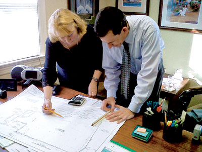 FRANKLIN TOWNSHIP, N.J.: Bonnie Butler '79, township council member, reviews plans for a proposed recreation field with consulting engineer Mike Finelli '82.