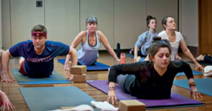Following instructor Terrence Monte's lead, our writer Bill Landauer (left) attempts yoga.