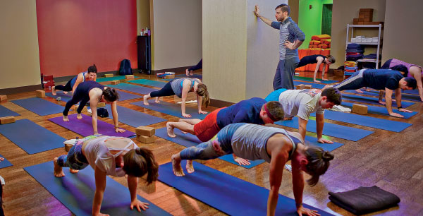 Monte's yoga students  at Pure Yoga East on  New York's Upper East side pose in the plank position.