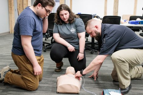 Student emergency medical technicians learn about CPR.