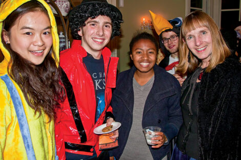 Lafayette College President Alison Byerly with students dressed up for Halloween