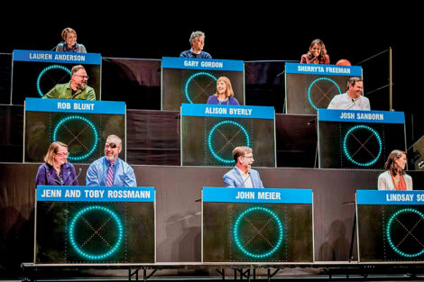 President Alison Byerly is seated as the center square in a Hollywood Squares game with other faculty and staff