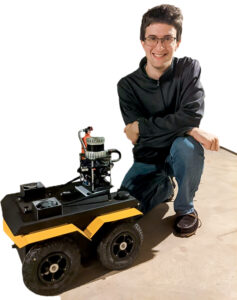 Ian Miller with a robot