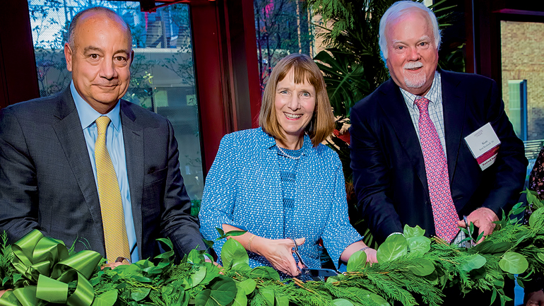 Lafayette College President Alison Byerly cuts a green swag with Robert Sell and S. Kent Rockwell