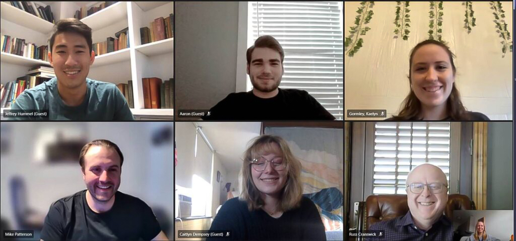 a grid of smiling students and alumni participate in a Zoom call