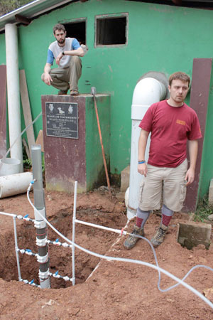 "Mickey Adelman '10 (left) testing innovative water-filtration technology in Marcala, Honduras. ""Our direct applications are in the developing world, but good science in this area is important here in the United States as well."""