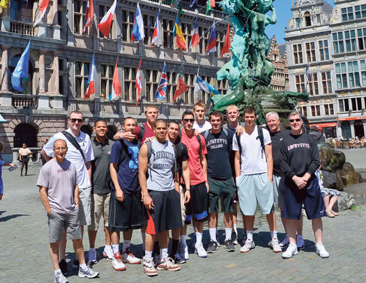 While in Europe the men's basketball team (above) visited Antwerp's central square and its monument honoring the city's mythical hero, Silvius Brabo, and the field hockey team enjoyed time along the River Thames in London.