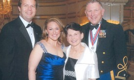 Duncan O'Dwyer '60, wearing the New York Conspicuous Service Cross, which he received from Governor George Pataki, with his wife Alice, daughter Pam McGaan, and her husband, Andy McGaan.