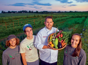 John Soder, executive chef of dining services, holds some of the LaFarm produce used in the College dining halls.